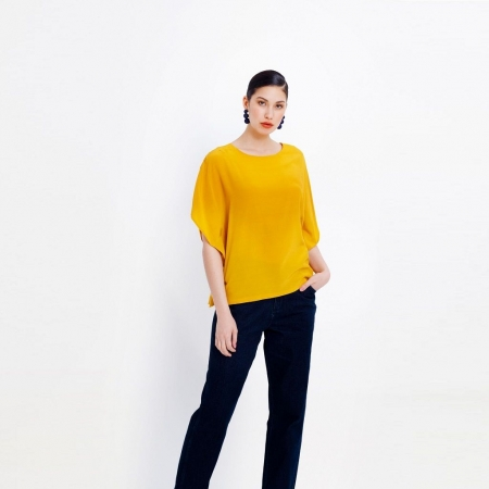 Model wearing Circkel top - Yellow