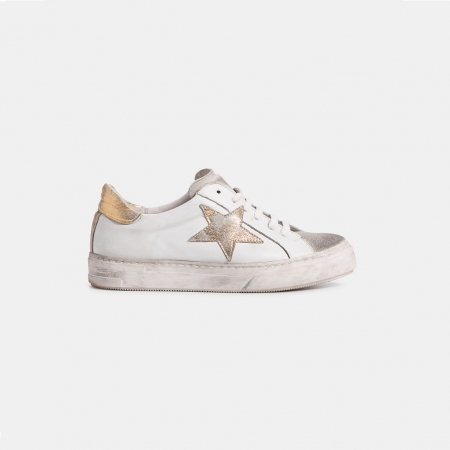 The sneaker- swank white with gold star