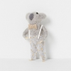 North Pole hanging koala boy with champagne bow standing