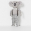North Pole hanging koala boy with silver bow standing