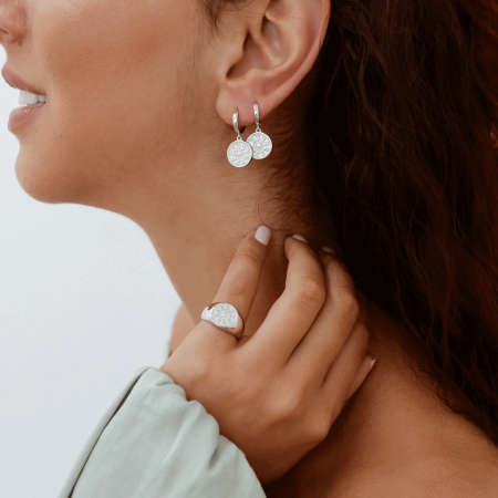 model wearing pella earrings silver