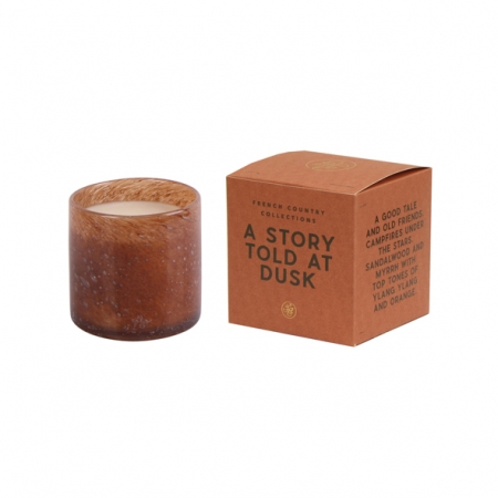 A story told at dusk glass candle-amber